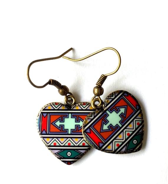 Tribal Print Heart Charm Earrings. 3.25 Ratti Emerald. Gilson Emerald. Bright Green Emerald. 1.3 Carat Emerald. Watermelon Emerald. Hindi Emerald. Cloudy Blue Emerald. Brazil Found Emerald
