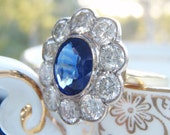 Vintage Sapphire & Diamond Statement Engagement Ring. A stunning ring with a natural 1.5 carat Sapphire and luminous 1.5 carat Diamond halo