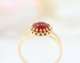 Carnelian ring | Delicate gold ring set with a carnelian gemstone