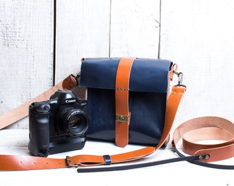 Camera bag + camera strap both with personalization. Tan color with dark blue.
