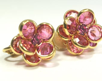 Sweet little pink faceted crystal earrings in a blooming flower design. Deep pink color set in gold petals.
