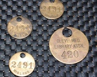 Four Vintage Brass Fobs