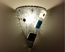 Wall sconce light with switch - Grey wall lamp shaped as a cone with squares cut on the right or left side. Great for framing a headboard