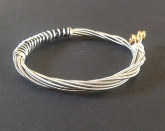 A Handmade Recycled Bass Guitar String Bracelet/bangle