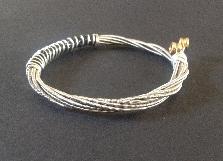 a handmade recycled bass guitar string bracelet bangle. Black Bedroom Furniture Sets. Home Design Ideas