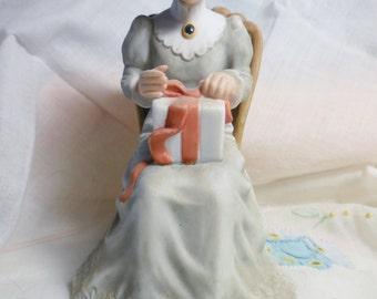 Enesco Treasured Memories Figurine: Mother Opening Gift