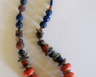tibetan coral beads... glass sherpa coral and lapis.