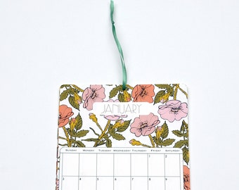2016 Wall Calendar, 5.5x8.5 inches featuring 12 different floral pattern illustrations in peach, pink, red, fuchsia, yellow and olive green