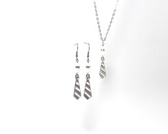 Earrings, necklace tie and white glass of my collection inspired by the trilogy Fifty shades of Grey