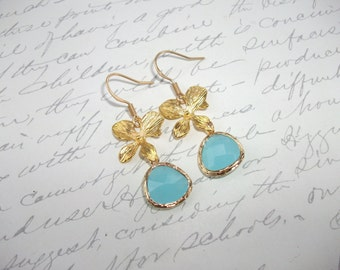 Turquoise framed glass drop earrings with gold orchid flowers