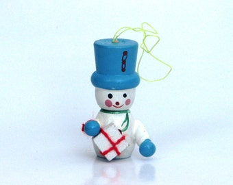 Vintage snowman Christmas ornament present gold white 1970s