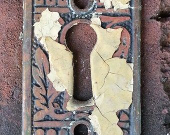 antique ornate keyhole cover escutcheon with paint