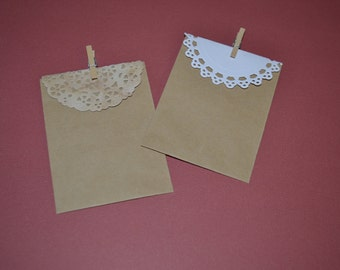 Gift wrap option small craft bag with doily and clothespin