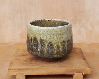 Textured wood fired stoneware tea bowl with light green glaze