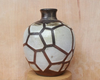 Wood fired stoneware vase with voronoi pattern in shino glaze