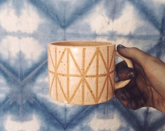 Geometric design speckled white satin matte ceramic mug