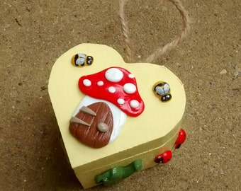 Miniature wooden heart jewellery trinket box with toadstool house (yellow) 8cm x 8cm