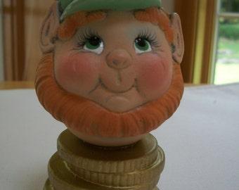 Leprechaun on gold coins St.Patrick's day ceramic decoration