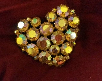 Vintage and beyond, HUGE brooch done up in a heart shape, with 17 large aurora borealis finished crystals. Each one in a multi-prong setting