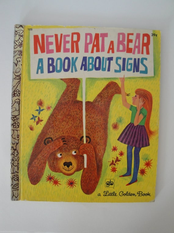 vintage 1971 golden book never pat a a book about signs