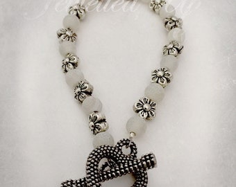 Pretty white and silver bracelet