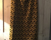 midi length pencil skirt- knitted jersey- African style pattern- yellow/ black
