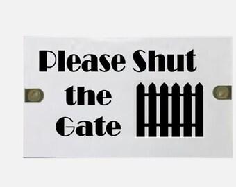 "Black and White ""Shut the gate"" sign"