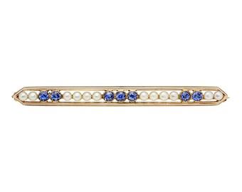 Antique sapphires, cultured pearls, 14 karat gold brooch.