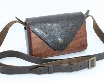 Wooden bag, Small dark wood clutch style handbag with brown textured leather flap, and removable cross body strap.