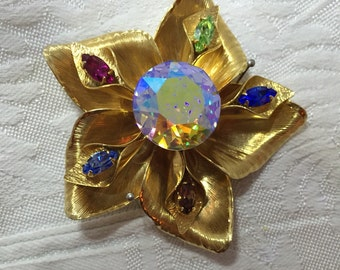 Warner gold tone flower with rhinestones
