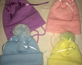 Knitted baby hat with ear flaps.  Made to order