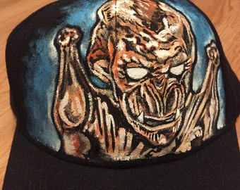 The Exquisite Corpse Custom Hand Painted Horror Movie Themed Baseball Caps and Snapbacks. Made To Order and Designed By You.