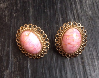 Pink with gold vintage earrings mounted on pinup girl playing card