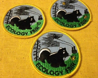 Vintage Ecology Fair Patches * Skunk and Flower with Factory Smog * Unused Patches