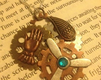 Steampunk necklace with gears, propeller, robot hand and one wing