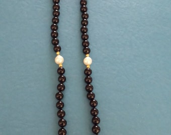 Onyx, pearl necklace clasp marked 14 k gold