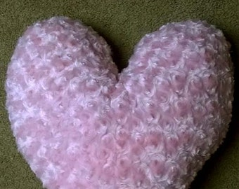 One heart shaped pillow