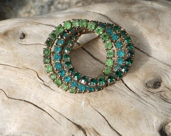 Vintage rhinestone pin.  Three interlocking circles pf sparkles.  Lime, teal and emerald.  Chic and classic.  1950's