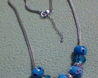 BLUE GLASS BEADS with a hint of pink.