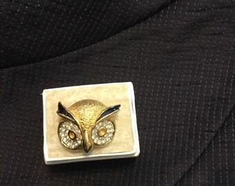 Owl gold tone brooch with rhinestones.