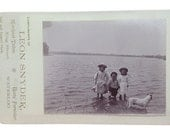 Cabinet Card photograph advertisement for Leon Snyder of 3 kids and a dog in the water