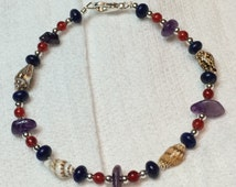 Lapis, Red Carnelian, and Amethyst bracelet with mini Conch Shells.