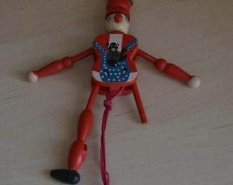 one-legged red clown