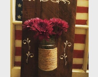 Mason jar on pallet wood display