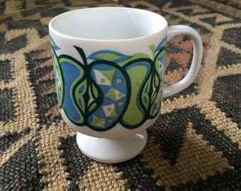 A retro blue and green vintage tea cup