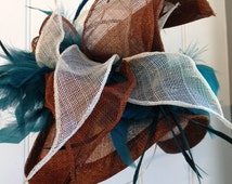 Aqua Fascinator, with striking addition of white and chocolate brown.Very striking look achieved with dark  torquay feather pumice