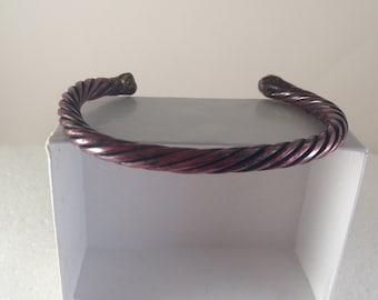 Red copper braided bangle bracelet.