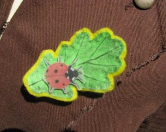 Ladybird and leaf brooch.