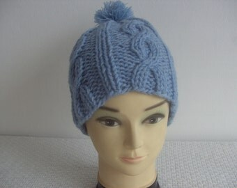 Hand knit wool hat with traceries and pompon