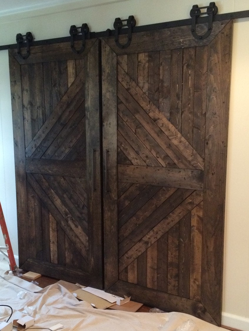 Custom made handmade wooden interior rustic sliding barn for Custom made wood doors